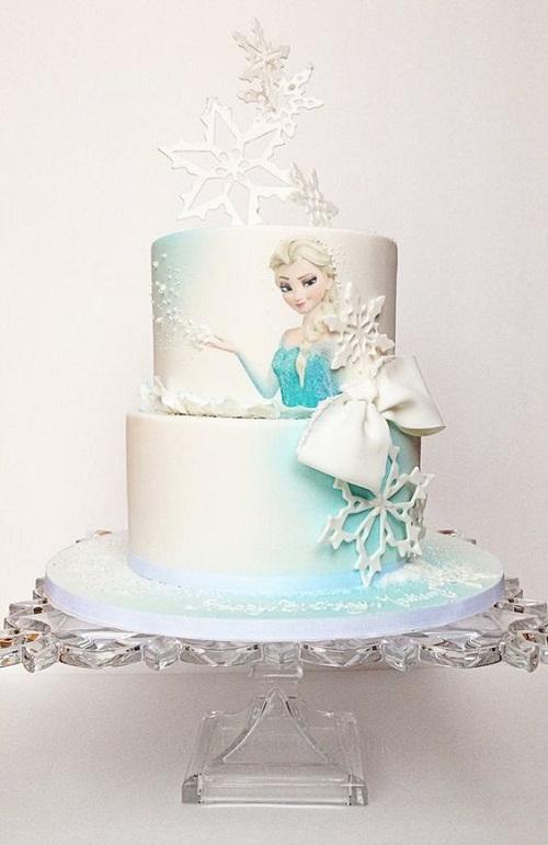 Flocos de neve brancos com Elsa congelado o bolo de aniversário